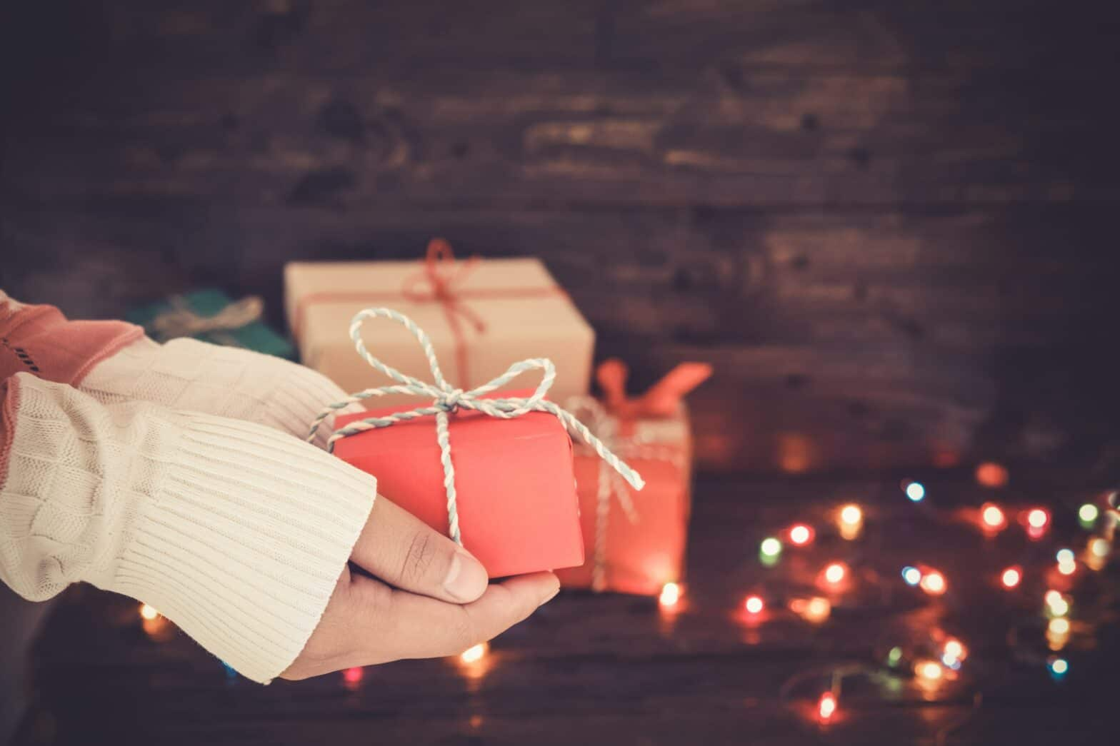 Hands giving a gift